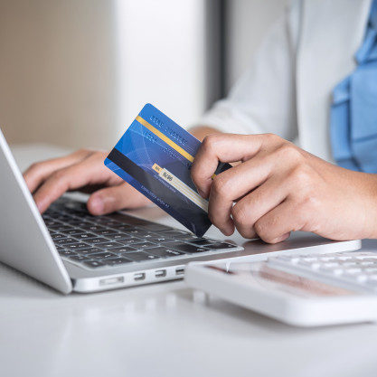 hands-holding-credit-card-typing-laptop-online-shopping-payment-make-purchase_122498-23