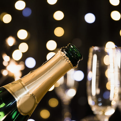 new-year-background-with-champagne_23-2148002052